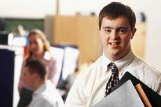 man with down syndrome working in an office